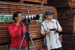 Shalya Harris and Keith Rozendal record operations at the wood port in Douala, Cameroon